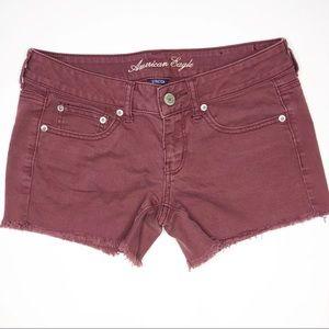 American Eagle low rise frayed burgundy shorts